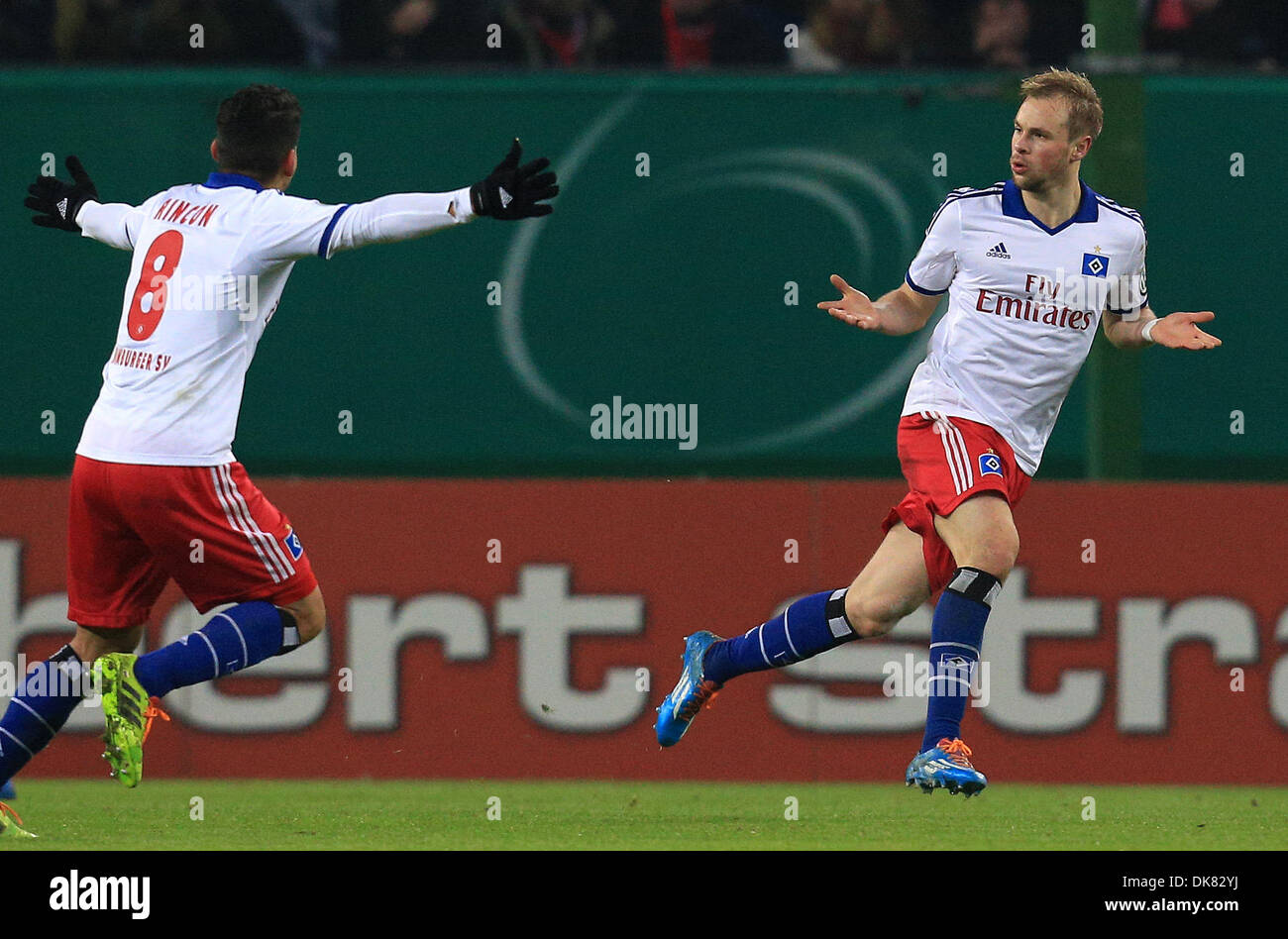 Hamburg, Germany. 3rd Dec 2013.Hamburg's Maximilian Beister (R) cheers his 1-0 goal together with team mate Tomas Rincon during the DFB cup round of 16 soccer match Hamburger SV vs 1. FC Cologne at Imtech Arena. Credit:  dpa picture alliance/Alamy Live News - Stock Image