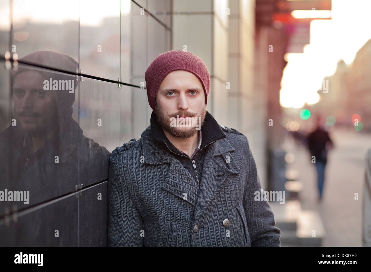 Young, stylish hipster with moustache and beard - Stock Image