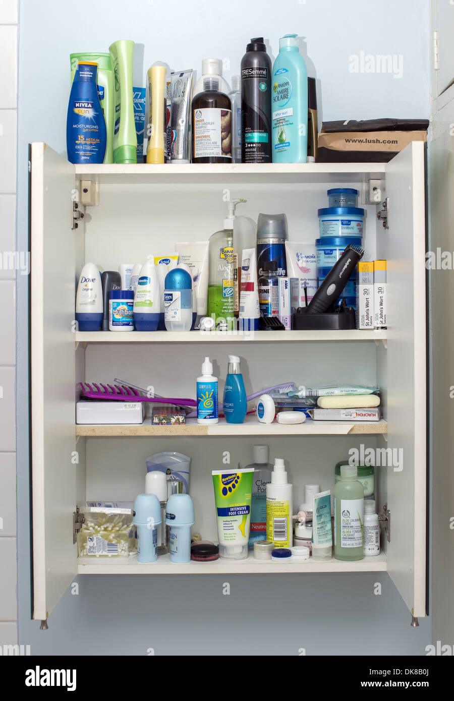 Bathroom cabinet full of toiletry and healthcare products - Stock Image