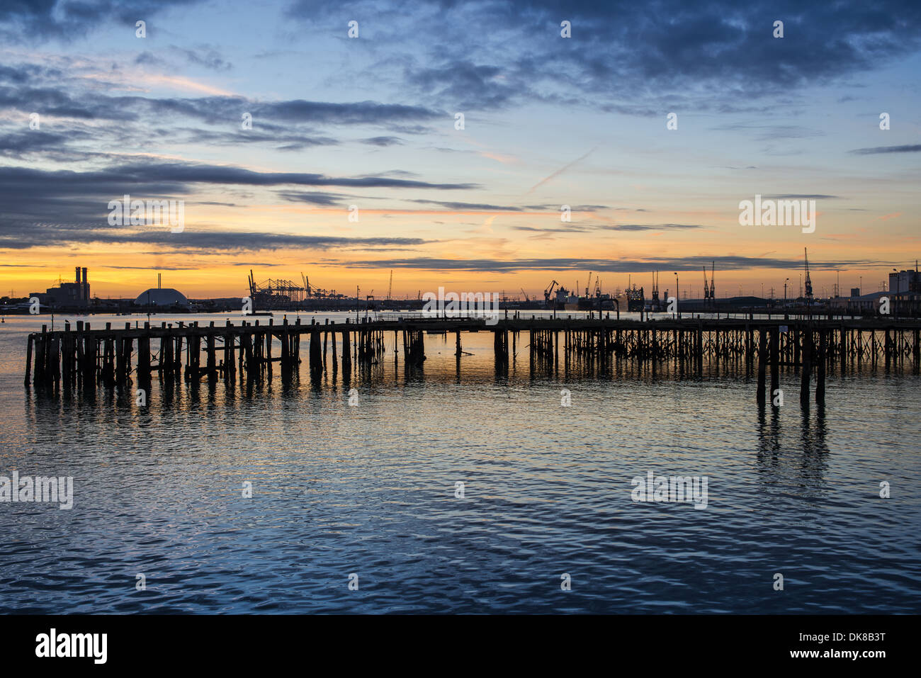 Silhouette of the remains of the old Royal Pier against a beautiful sunset over Southampton docks in Hampshire, England, UK - Stock Image