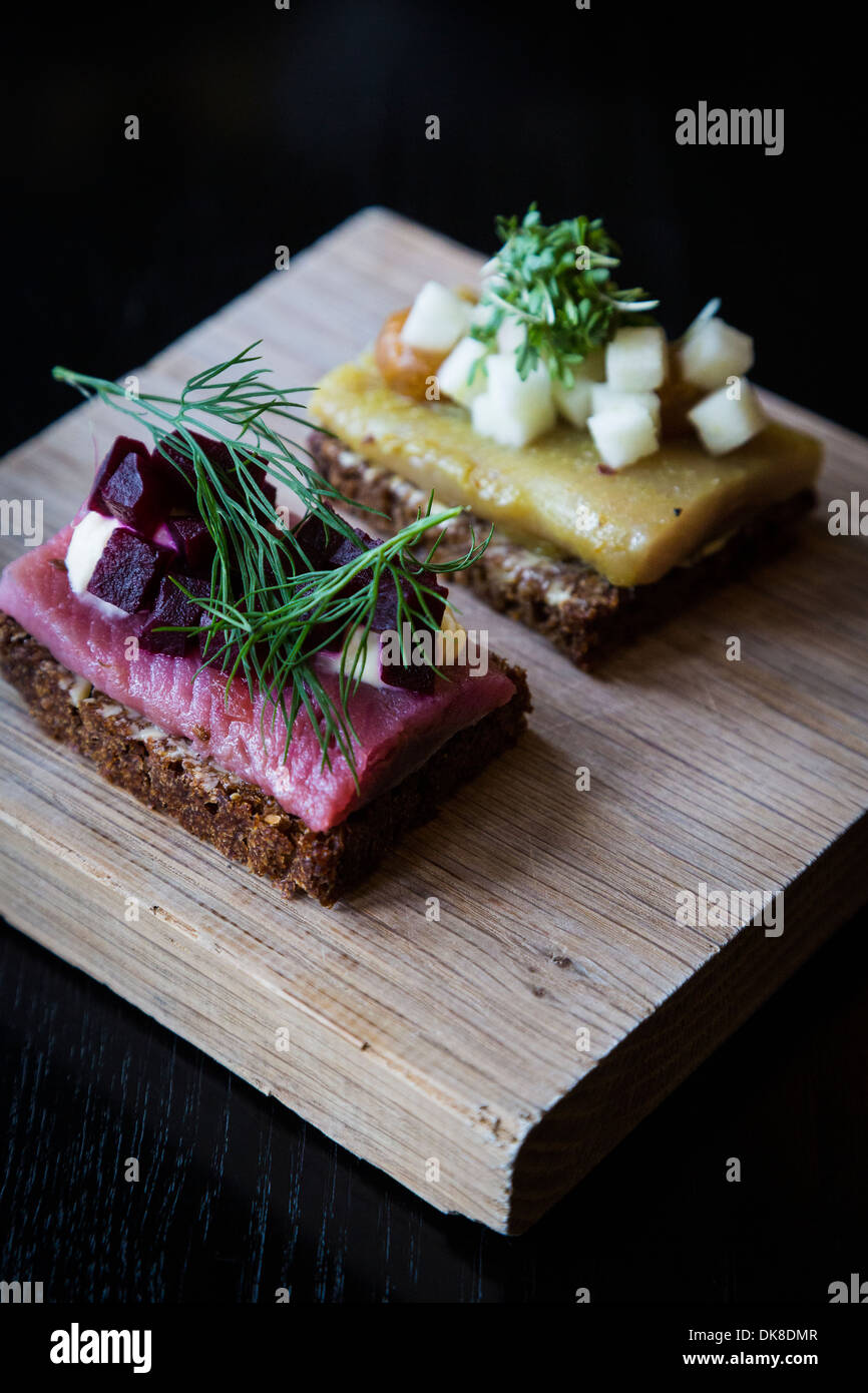 Small danish smorrebrod of herring fish served as part of the Ammanns Lunch, Aamanns Restaurant, Copenhagen, Denmark. - Stock Image