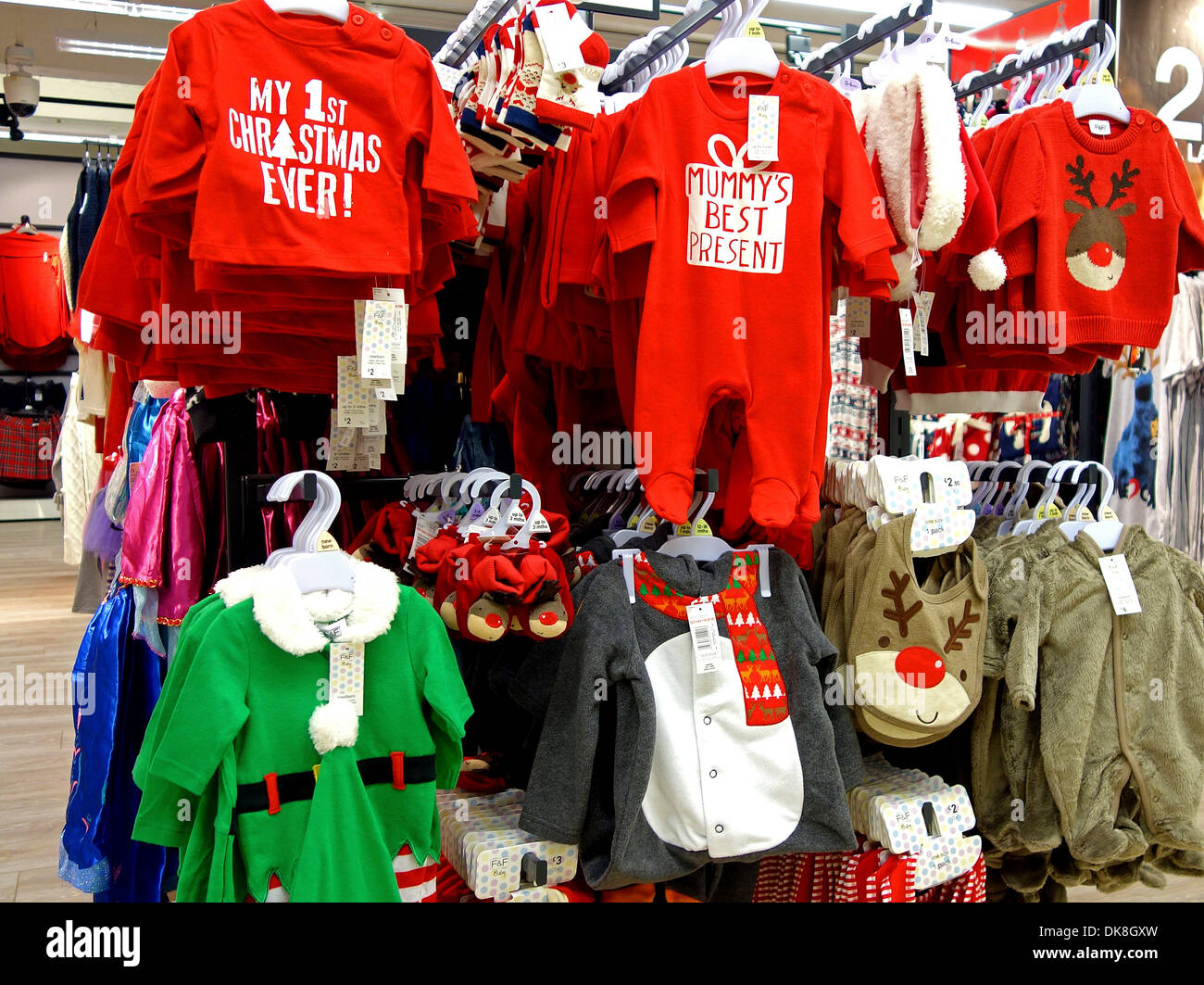 b6df62c2a0f4 Christmas design baby clothes in a Tesco store, UK Stock Photo ...