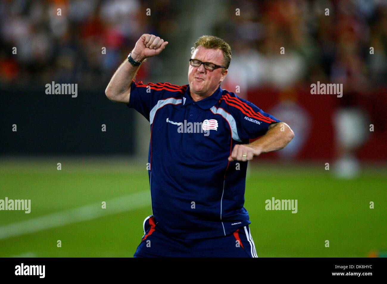 July 23, 2011 - Commerce City, Colorado, U.S - New England Revolution head coach Steve Nicol reacts dramatically in the second half.  The match ended in a 2-2 tie.  The Rapids hosted the Revolution at Dick's Sporting Goods Park in Commerce City, CO. (Credit Image: © Isaiah Downing/Southcreek Global/ZUMApress.com) - Stock Image