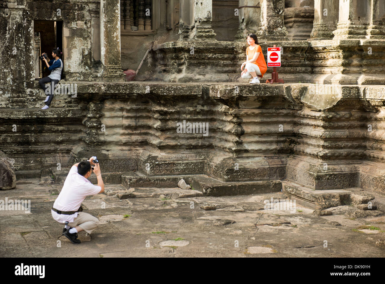 Some tourist violate roul of Angkor War, Siem Reap, Cambodia - Stock Image