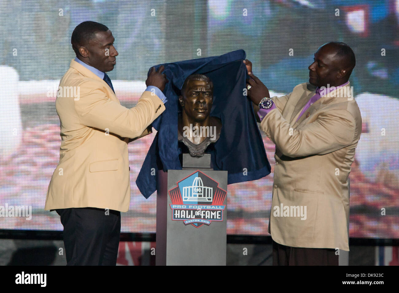 Aug. 6, 2011 - Canton, Ohio, U.S - Enshrine Shannon Sharpe and his brother and presenter Sterling Sharpe unveil Shannons bust during ShannonÃ•s enshrinement into the Pro Football Hall of Fame at Fawcett Stadium in Canton Ohio. (Credit Image: © Frank Jansky/Southcreek Global/ZUMAPRESS.com) - Stock Image