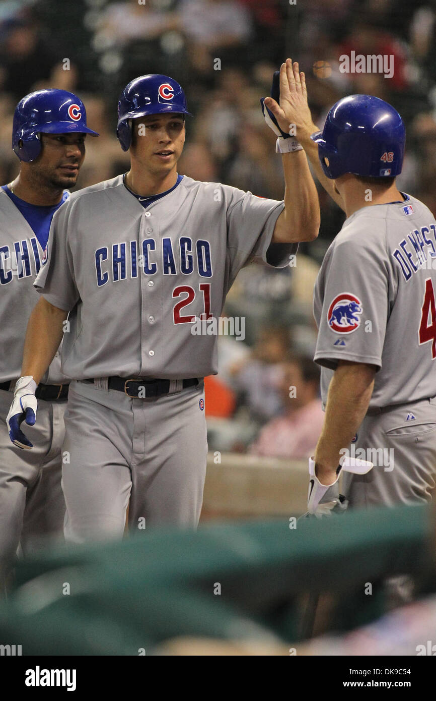 Aug. 16, 2011 - Houston, Texas, U.S - Chicago Cubs outfielder Tyler Colvin (21) gets congratulated for hitting a home run. The Houston Astros beat the Chicago Cubs in the second game of the series 6-5 on a walk off Grand Slam by Houston Astros outfielder Brian Bogusevic (19) at Minute Maid Park in Houston, TX. (Credit Image: © Luis Leyva/Southcreek Global/ZUMAPRESS.com) - Stock Image