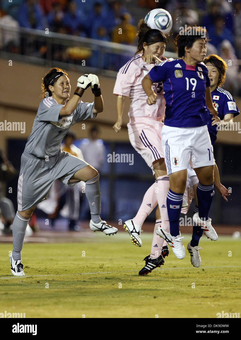Aug. 19, 2011 - Tokyo, Japan - MEGUMI TAKASE (R) of Japan Women's National Team in action during the charity match for the earthquake and tsunami victims at the National Stadium in Tokyo, Japan. Japan Women's National Team defeated Nadeshiko League Team by 3-2. (Credit Image: © Shugo Takemi/Jana Press/ZUMAPRESS.com) - Stock Image