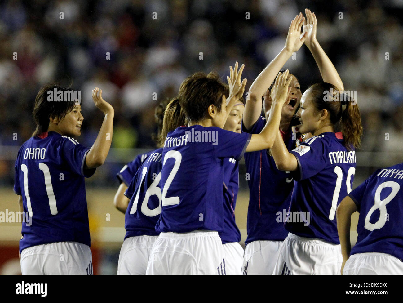 Aug. 19, 2011 - Tokyo, Japan - Players of Japan Women's National Team celebrate the score during the charity match for the earthquake and tsunami victims at the National Stadium in Tokyo, Japan. Japan Women's National Team defeated Nadeshiko League Team by 3-2. (Credit Image: © Shugo Takemi/Jana Press/ZUMAPRESS.com) - Stock Image