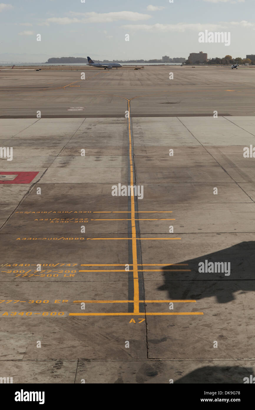 Airplane parking reference guide lines - San Francisco International Airport - San Francisco, California USA - Stock Image