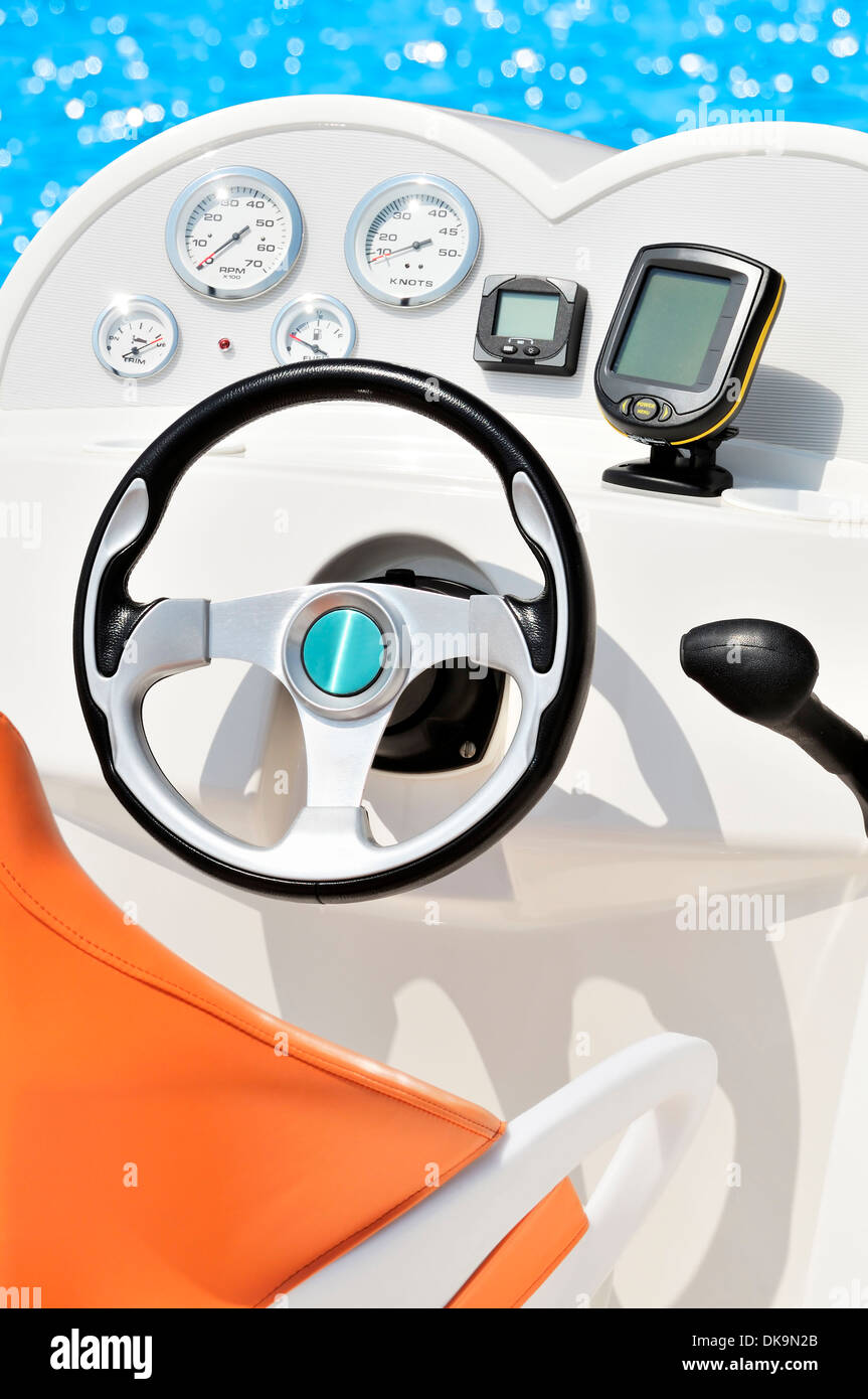 Instrument panel and steering wheel of a motorboat Stock Photo