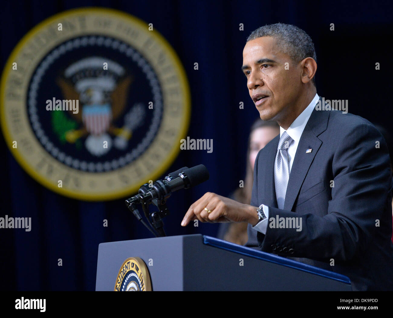 Washington DC, USA. 3rd December 2013. U.S. President Barack Obama speaks on the affordable care act in the South Court Auditorium of the White House in Washington DC Dec. 3, 2013. Barack Obama on Tuesday launched a three-week coordinated campaign with Democrats at Capitol Hill and outside allies to reboot his signature healthcare overhaul, following two months of intense media coverage of the federal healthcare website failures. (Xinhua/Zhang Jun/Alamy Live News) - Stock Image