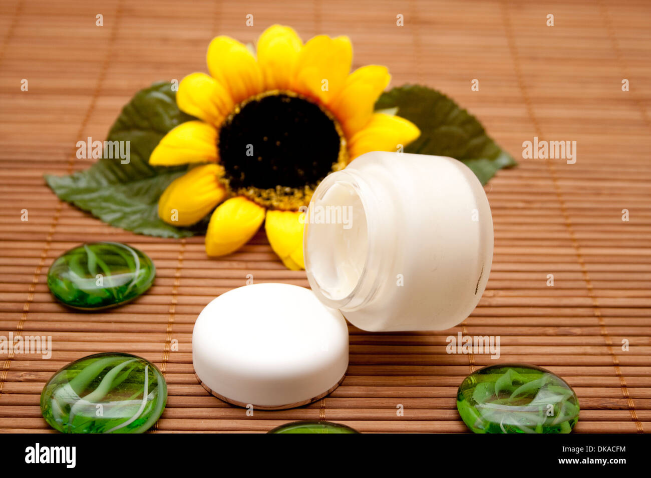 Face cream with glass stones - Stock Image