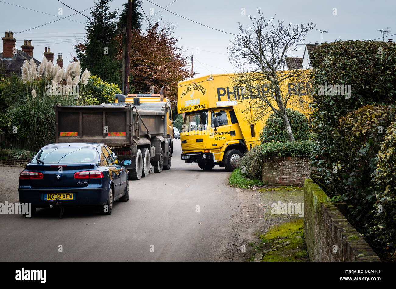 A removal van causing traffic congestion in a country lane in Wiltshire UK - Stock Image