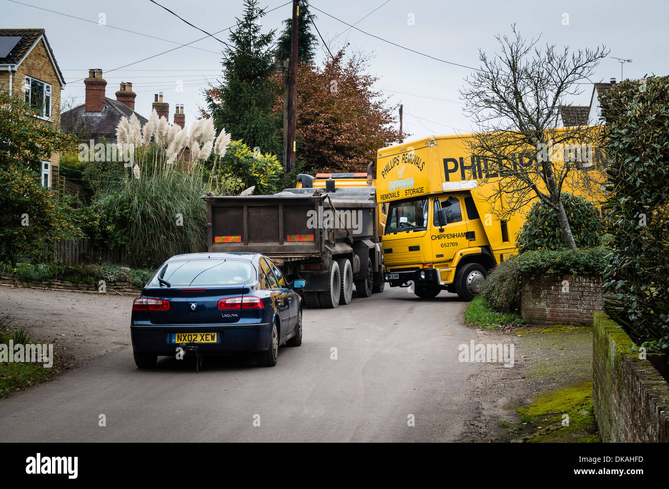 Traffic congestion in a narrow rural lane caused by a removal van at work in small village community - Stock Image