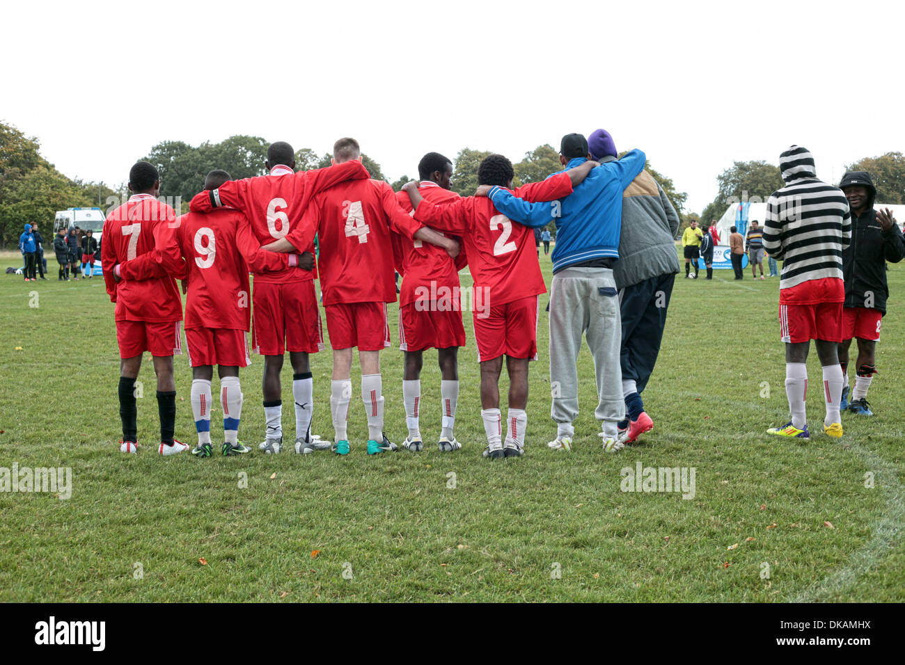 Football team huddle together during penalty shoot out. Playing football. - Stock Image