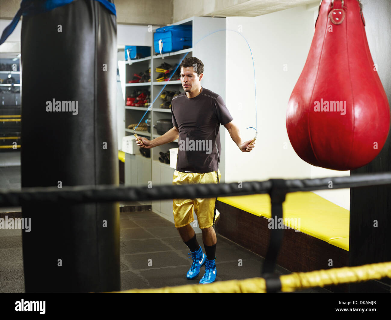Man skipping to warm up in changing room - Stock Image