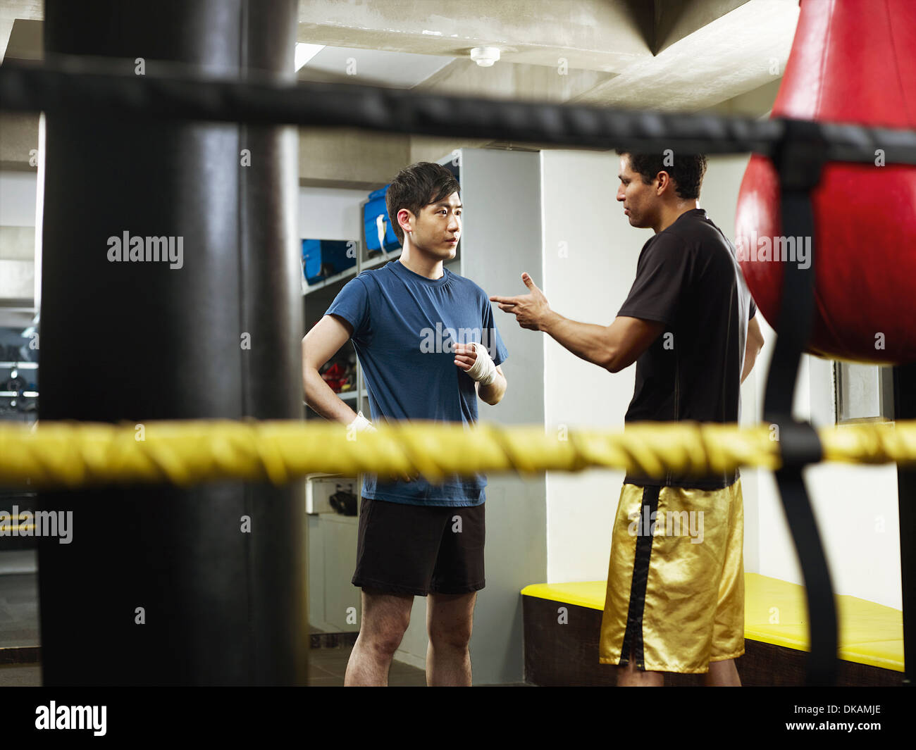 Boxers having conversation in changing room - Stock Image