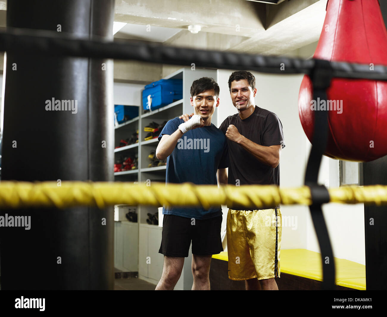 Boxers in changing room with clenched fists - Stock Image