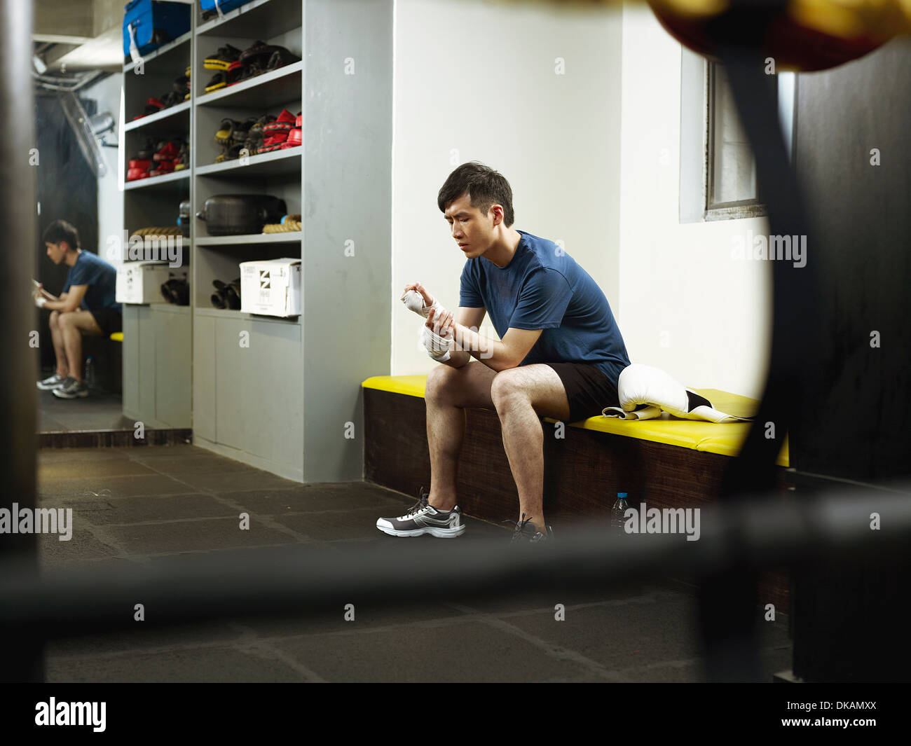 Boxer sitting in changing room - Stock Image