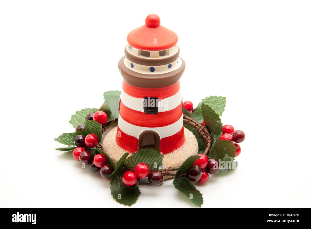 Lighthouse with berry wreath - Stock Image
