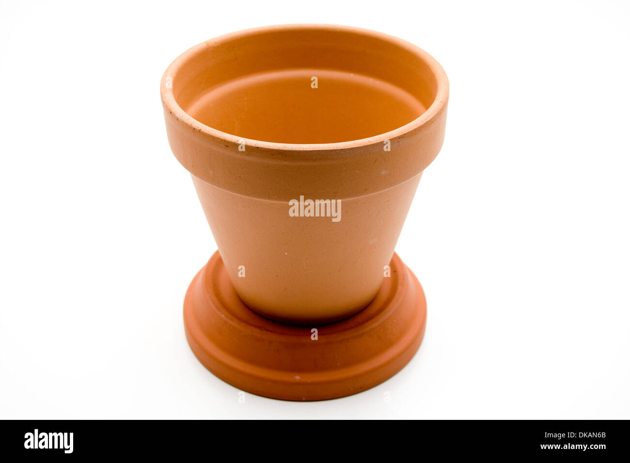 Plant pot with water bowl - Stock Image