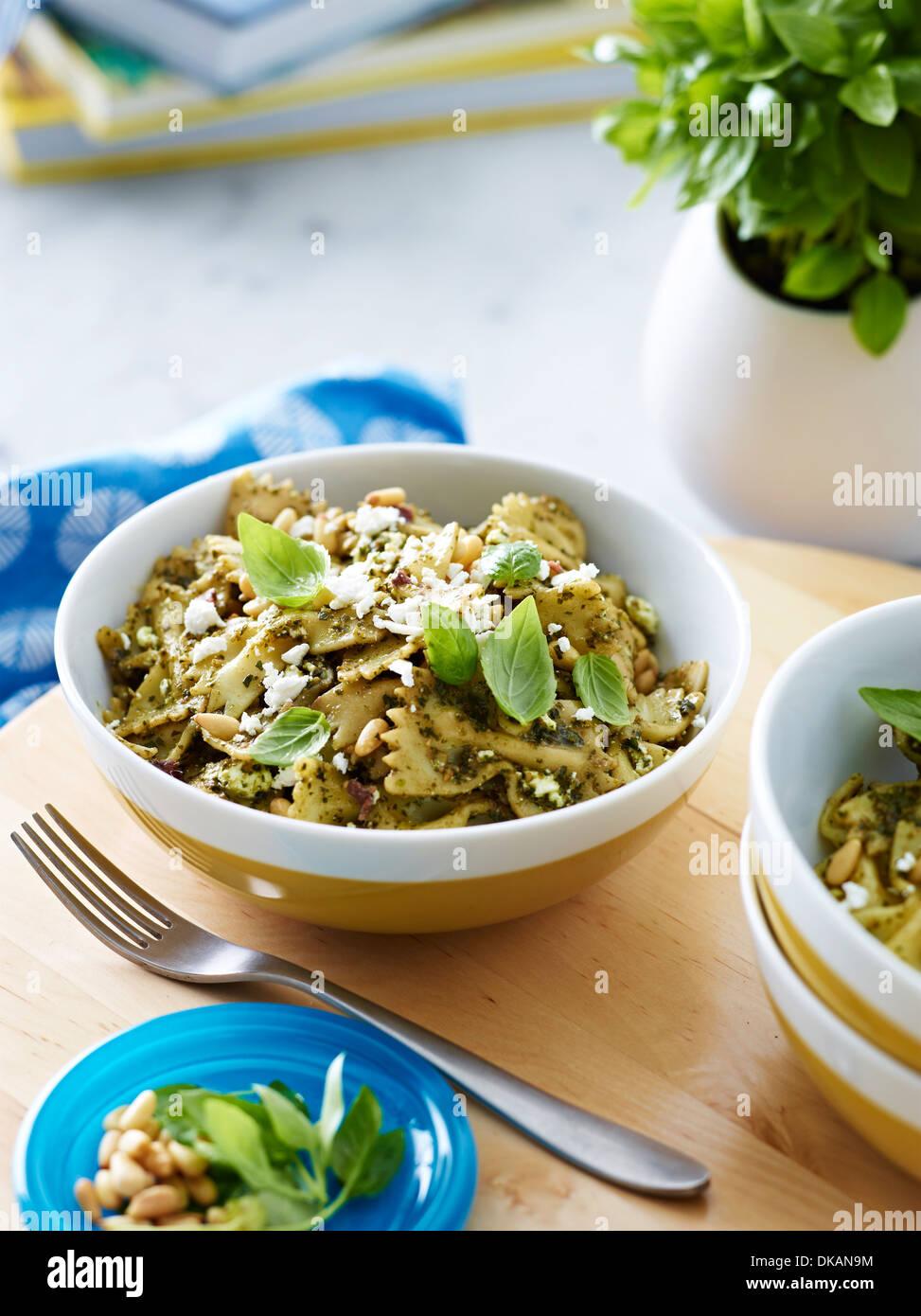 Bowl of farfalle pasta with herb garnish - Stock Image