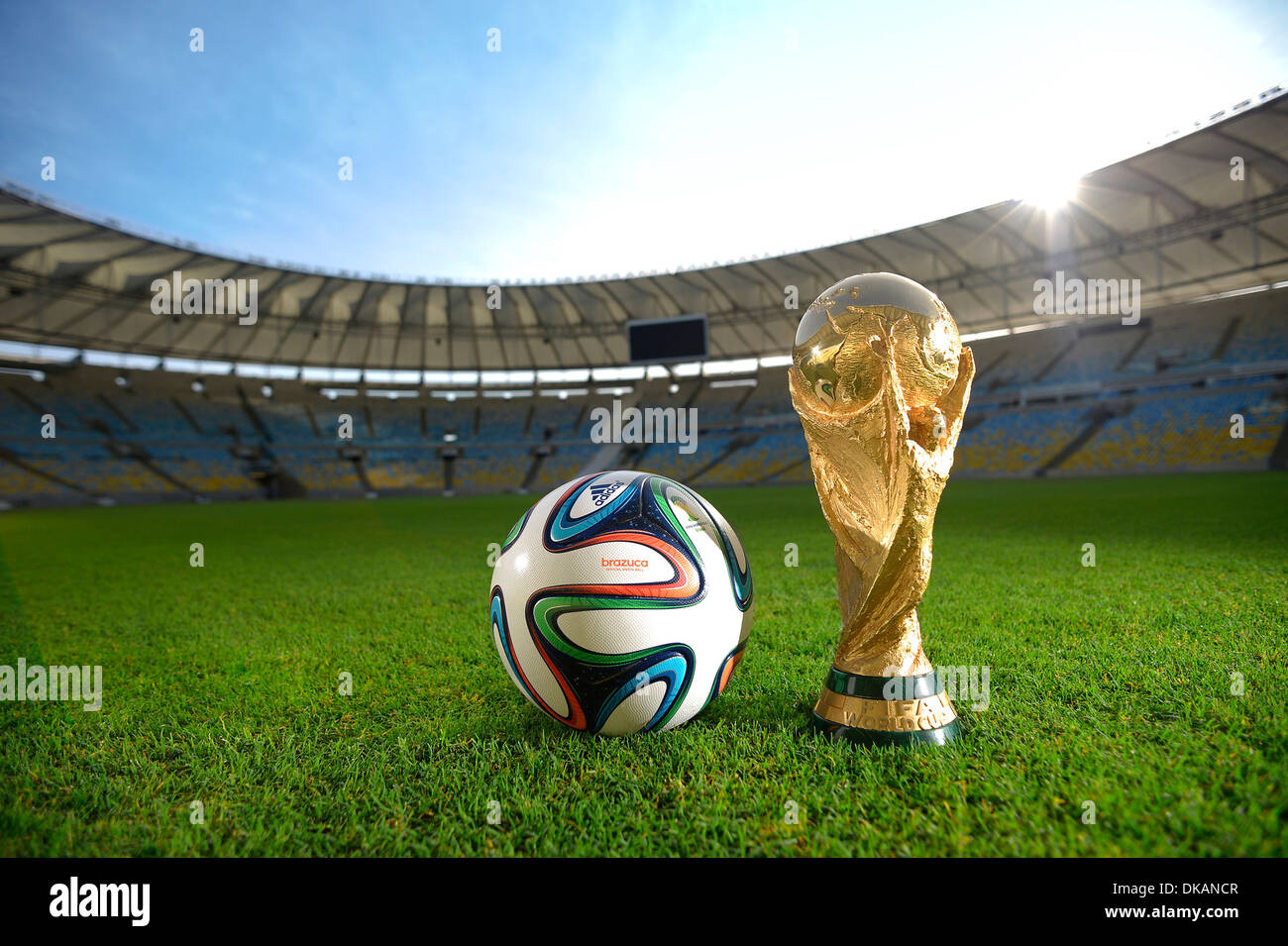Adidas Brazuca, official match ball of the FIFA World Cup Brasil 2014, and the official World Cup Trophy in Maracana Stadium - Stock Image