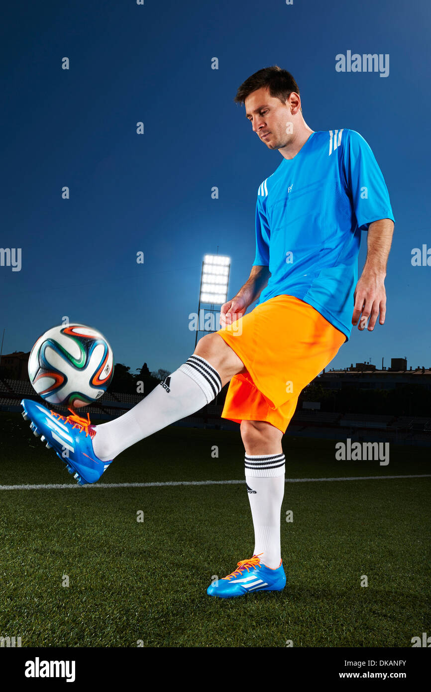 Lionel Messi (Argentina) with Adidas Brazuca, official match ball of the FIFA World Cup Brasil 2014 - Stock Image
