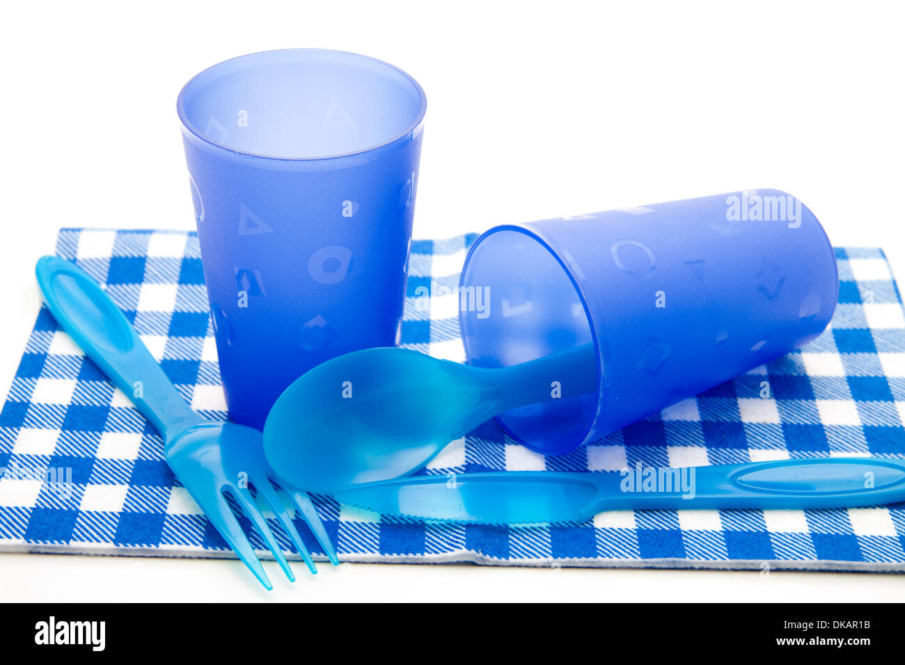 Blue drinking mugs with cutlery - Stock Image