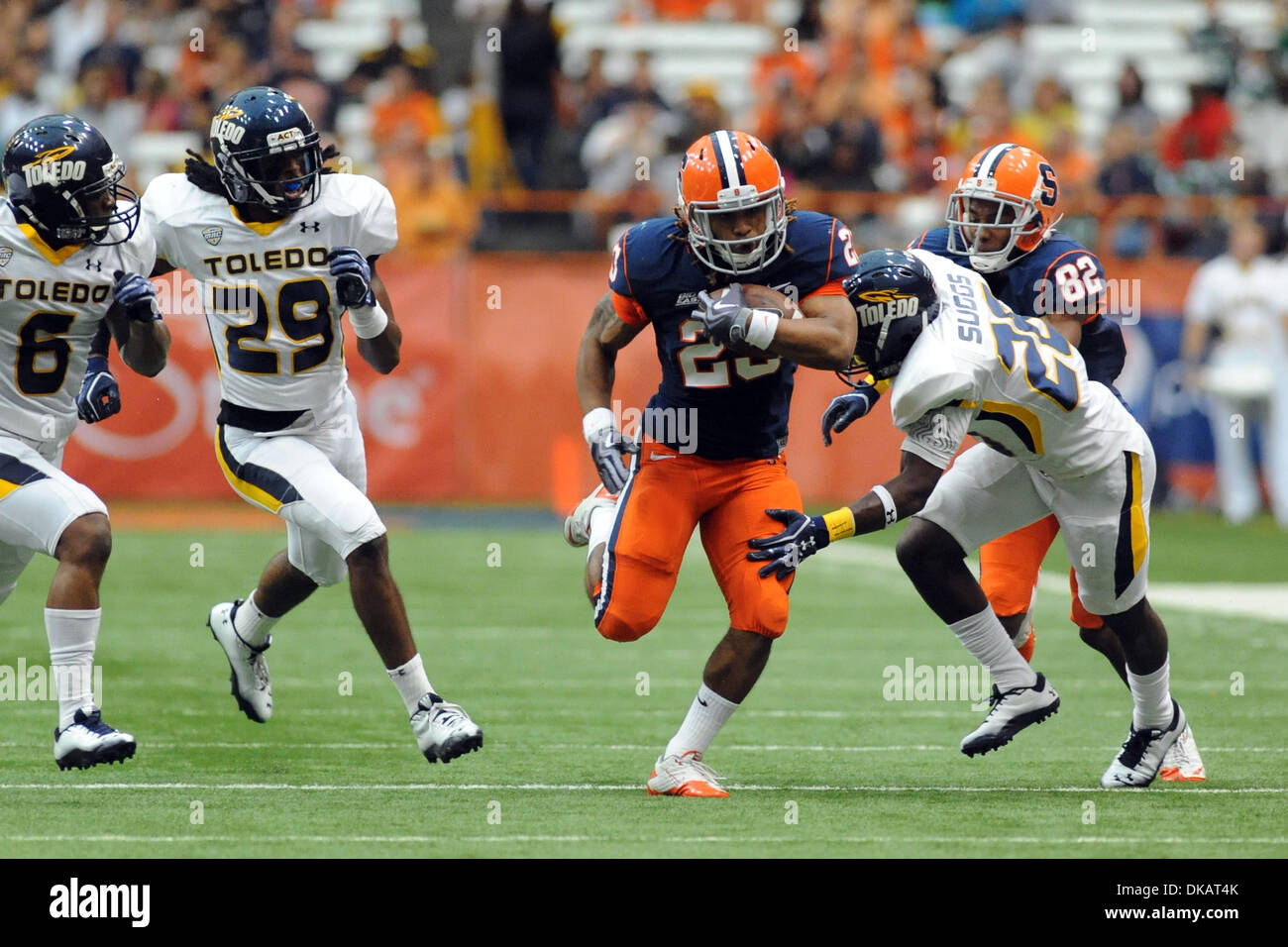 Sept. 24, 2011 - Syracuse, New York, U.S - Syracuse Orange running back Prince-Tyson Gulley (23) burst past Toledo Rockets cornerback Keith Suggs (26) in the second quarter at the Carrier Dome in Syracuse, NY.  Toledo and Syracuse went into the locker room tied at 13. (Credit Image: © Michael Johnson/Southcreek Global/ZUMAPRESS.com) - Stock Image