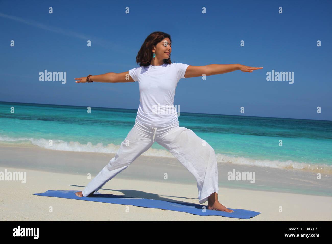 Young Woman Doing Yoga Warrior Pose Paradise Island Nassau Bahamas Stock Photo Alamy