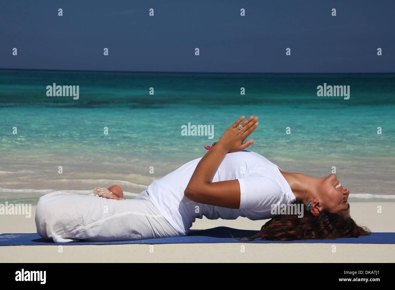 Young Woman On Beach Doing Yoga Paradise Island Nassau Bahamas Stock Photo 63548409 Alamy