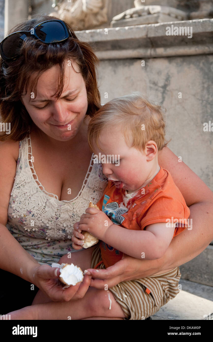 Young boy making a mess with an ice cream. - Stock Image