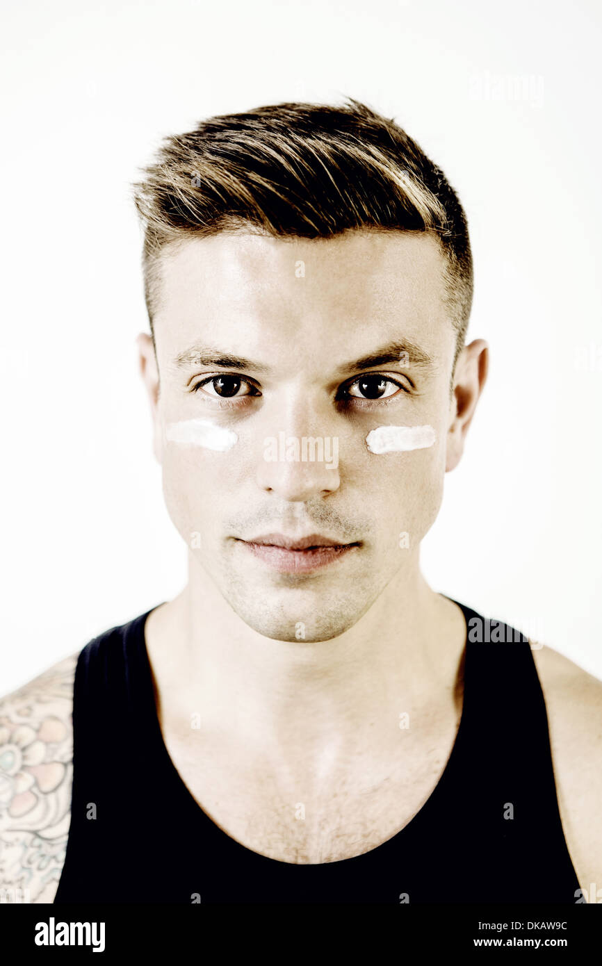 Portrait of mid adult man with makeup under eyes Stock Photo