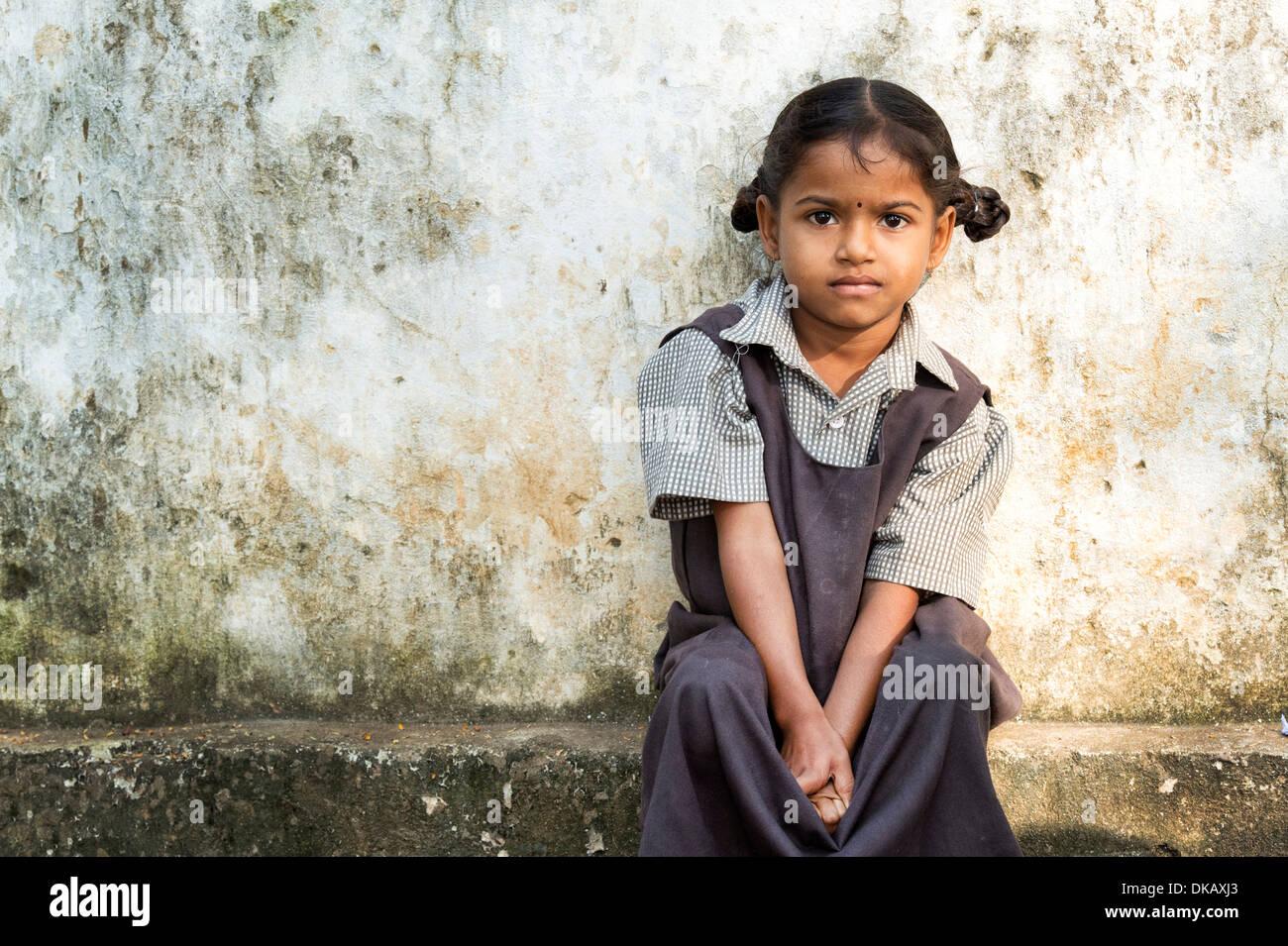 Rural Indian Village School Girl Sitting Against A Wall At School Andhra Pradesh India