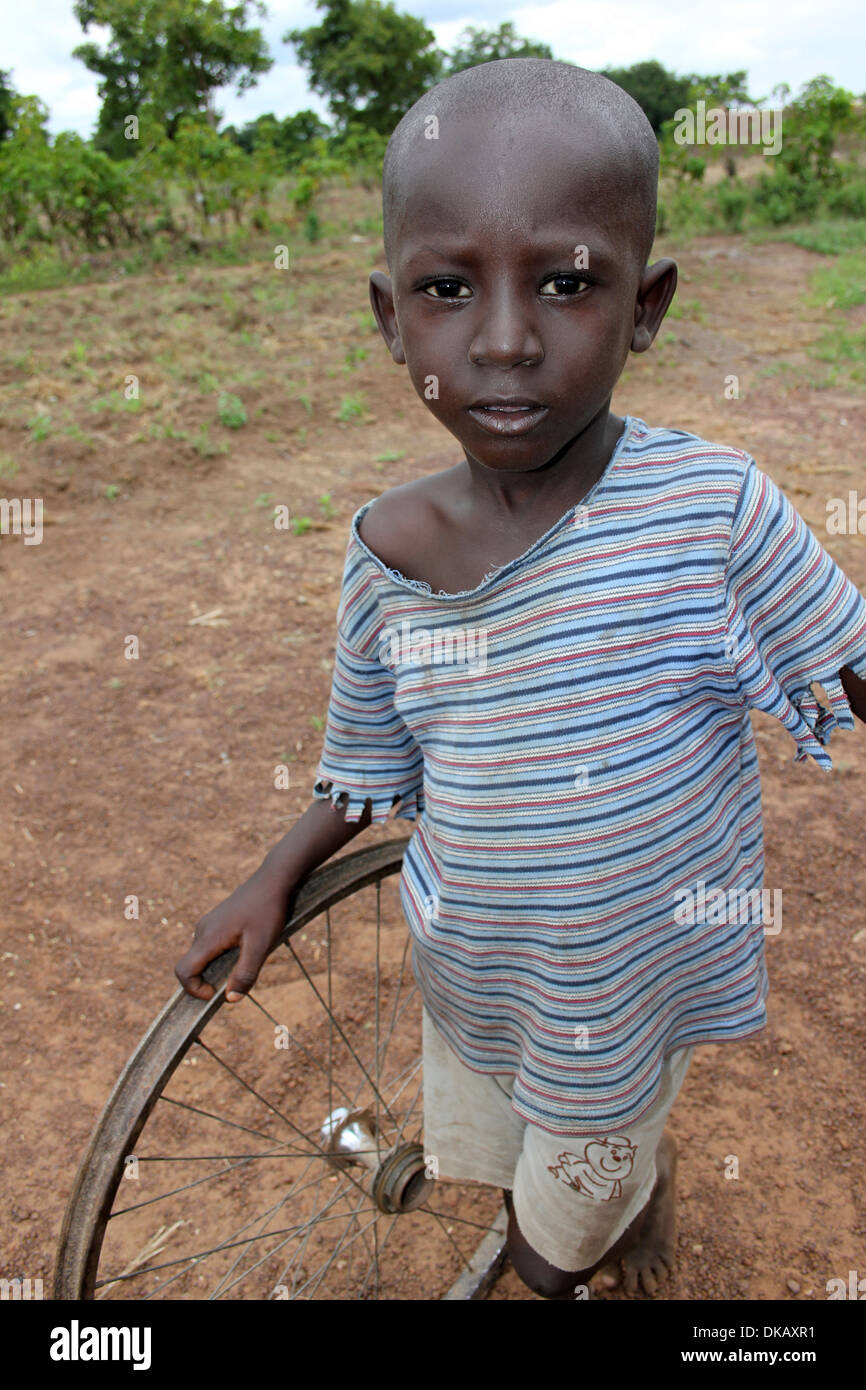 Ghanaian Boy With A Bicycle Wheel Plaything - Stock Image