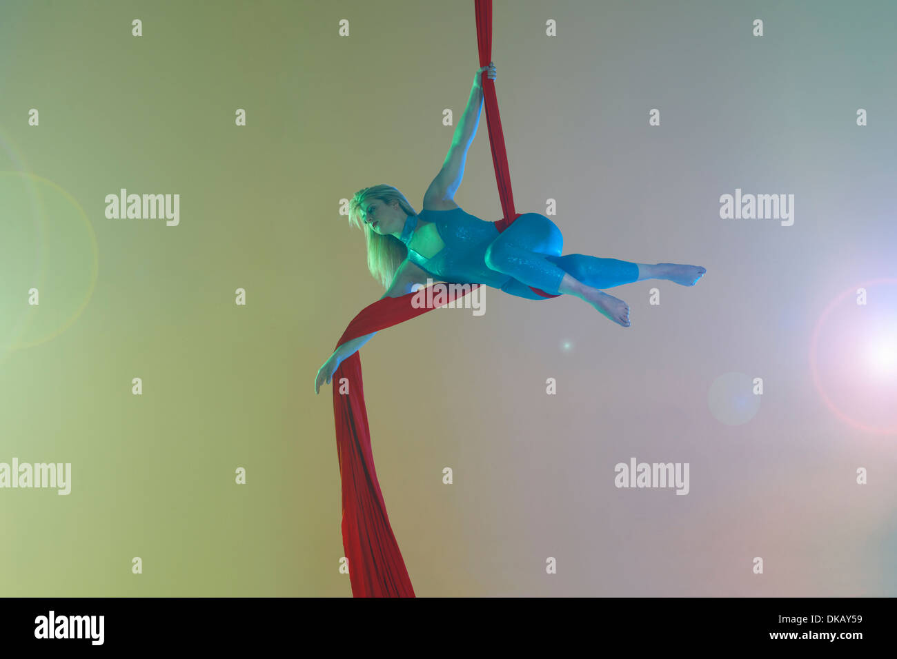 Aerial dancer with red ribbon - Stock Image