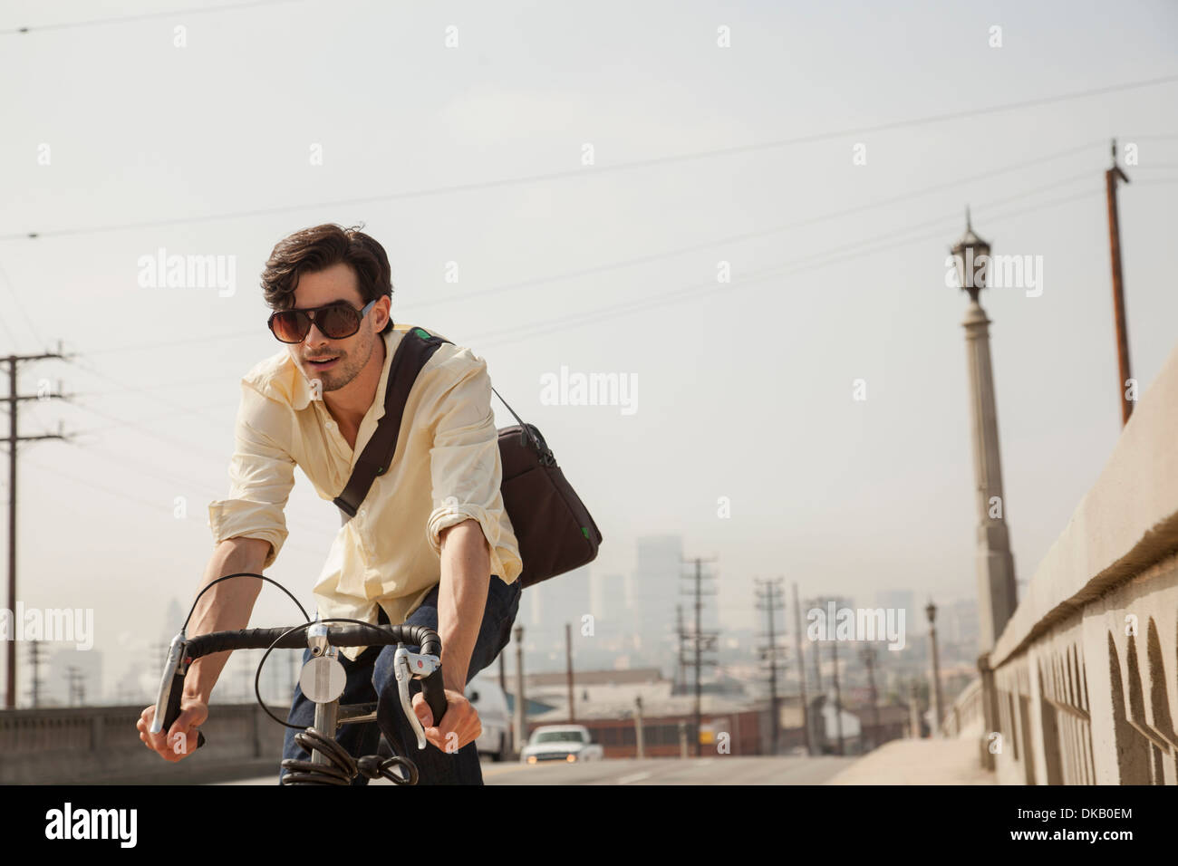 Man cycling on road, Los Angeles, California, USA Stock Photo