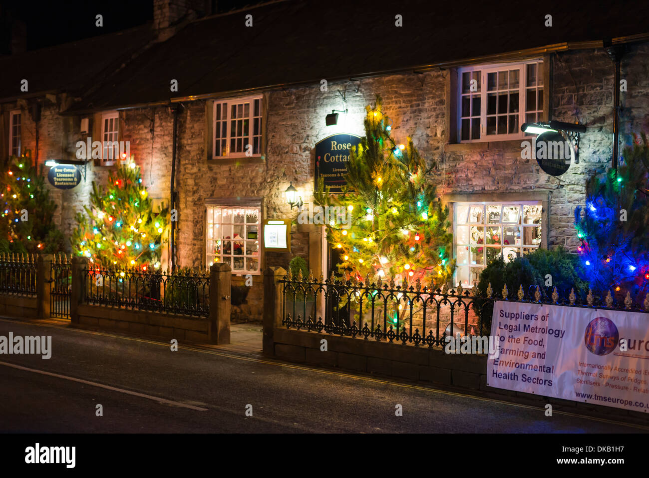 Christmas tree lights switched on in the Peak district village of  Castleton Derbyshire England Stock Photo