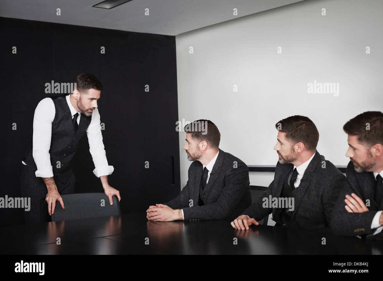 Businessmen in meeting, multiple image - Stock Image