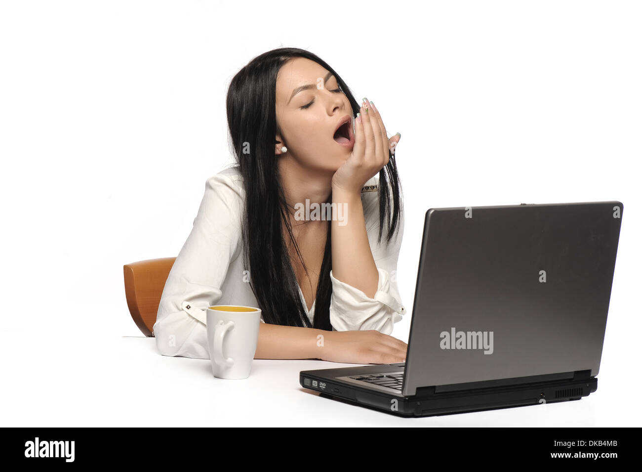 bored business woman working on laptop looking very boring at the