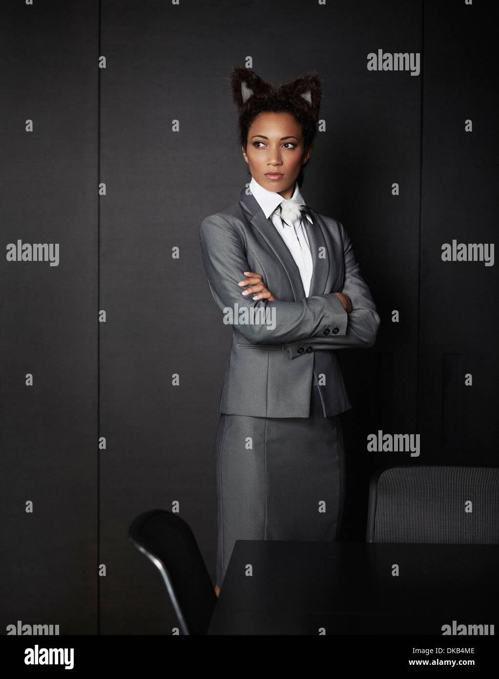 Businesswoman wearing fancy dress ears - Stock Image