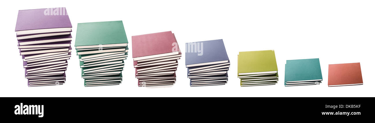 piles of hard covered colorful books isolated on white background