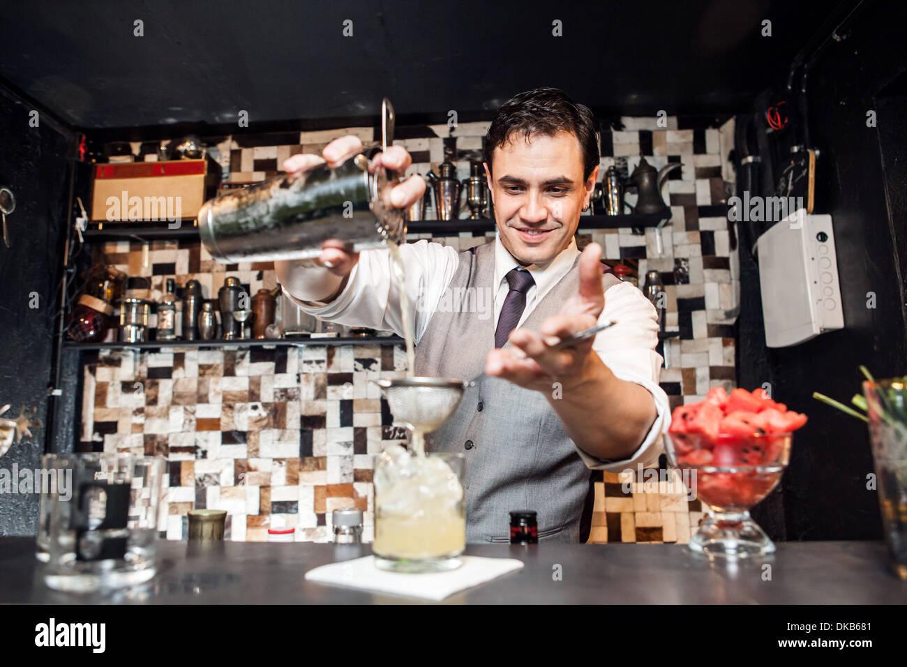 Barman mixing cocktail Stock Photo