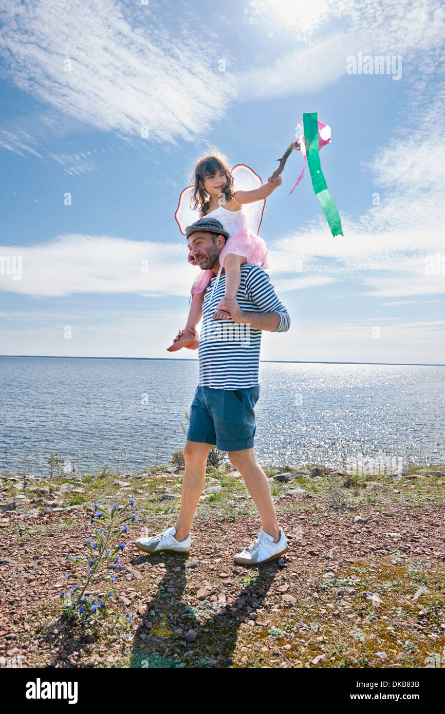 Father and daughter walking by sea, Eggergrund, Sweden Stock Photo