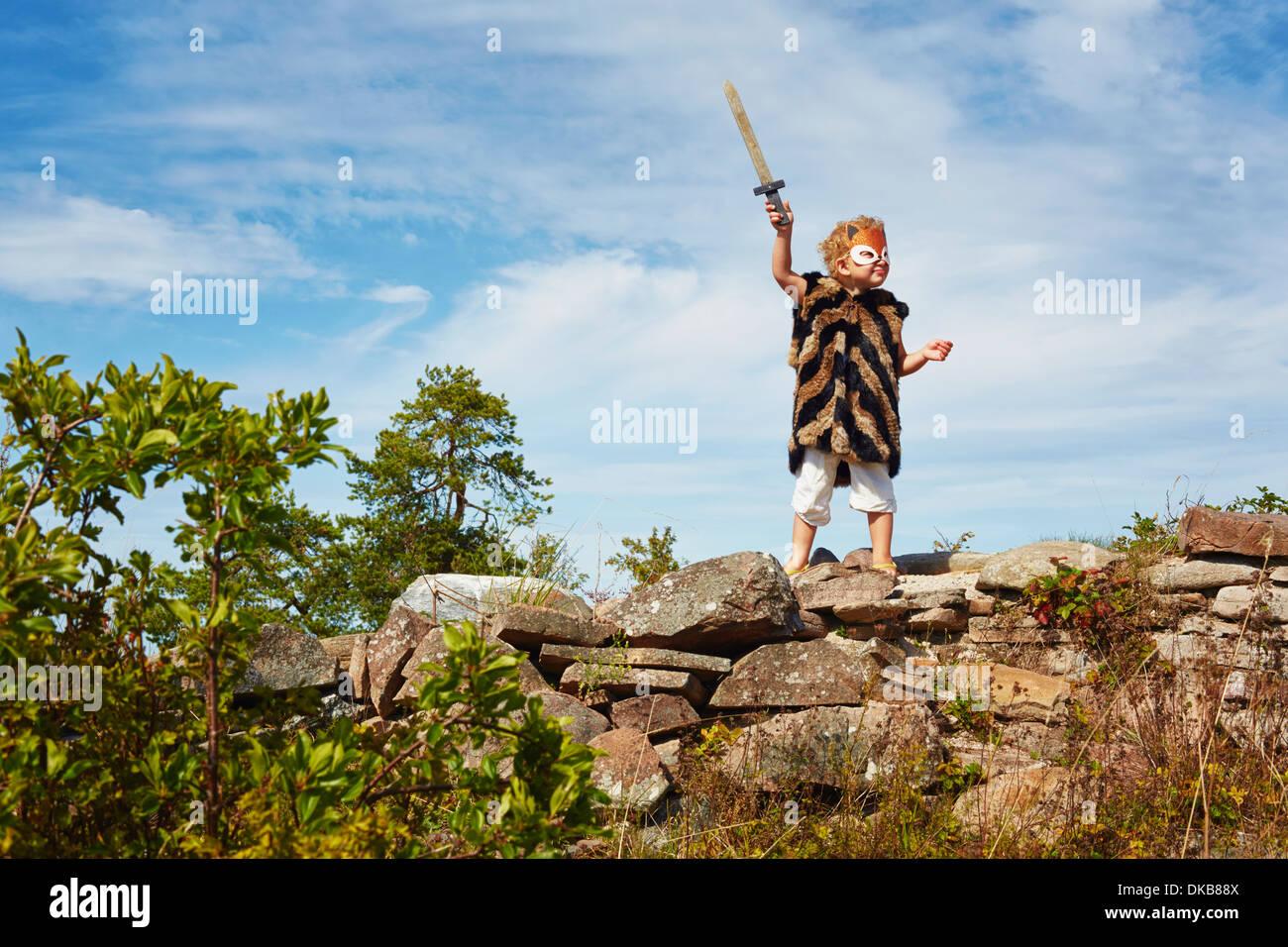 Girl holding wooden sword, Eggergrund, Sweden - Stock Image