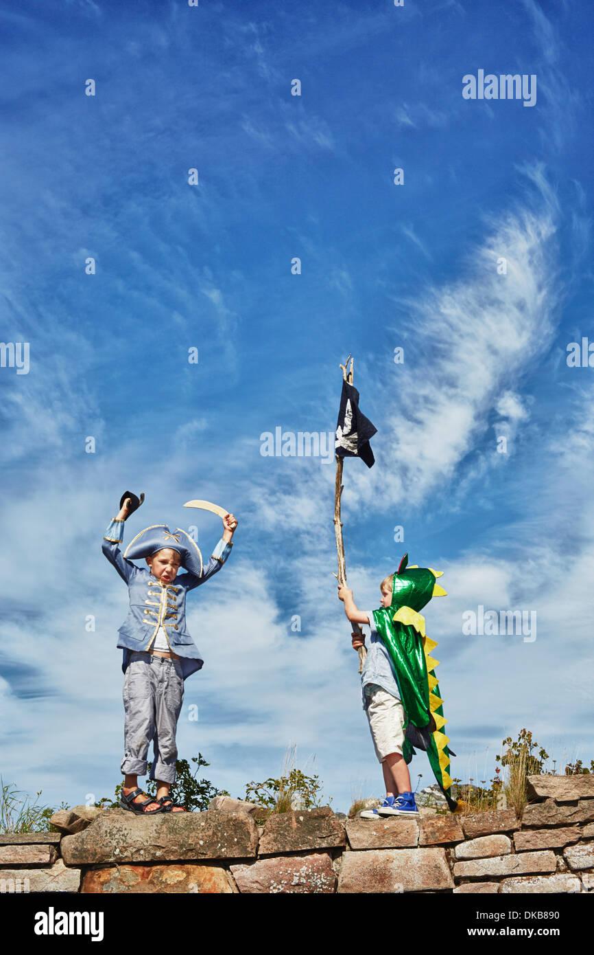 Two boys dressed up, one holding pirate flag, Eggergrund, Sweden - Stock Image
