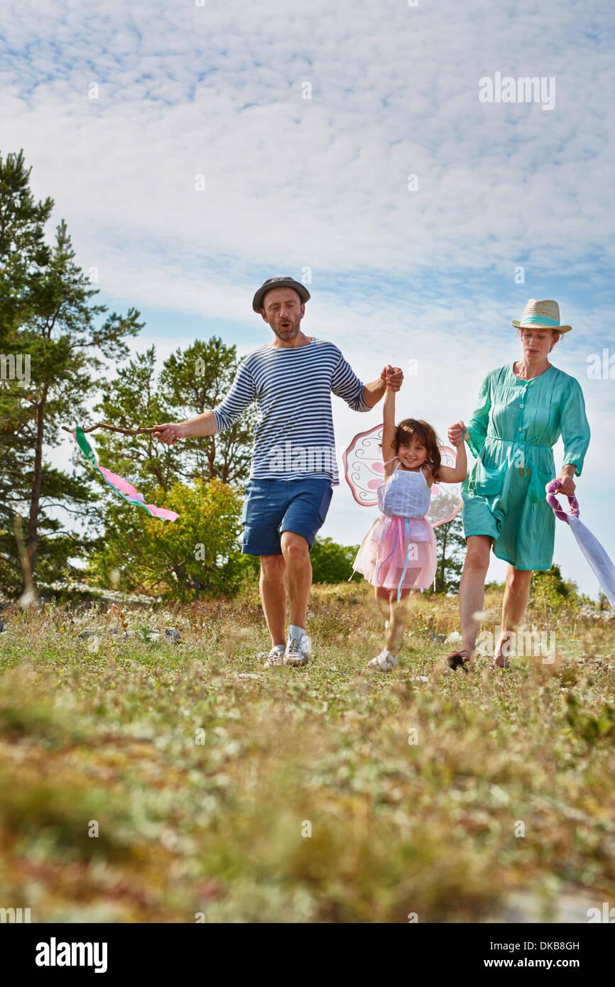 Parents with daughter holding hands, Eggergrund, Sweden - Stock Image