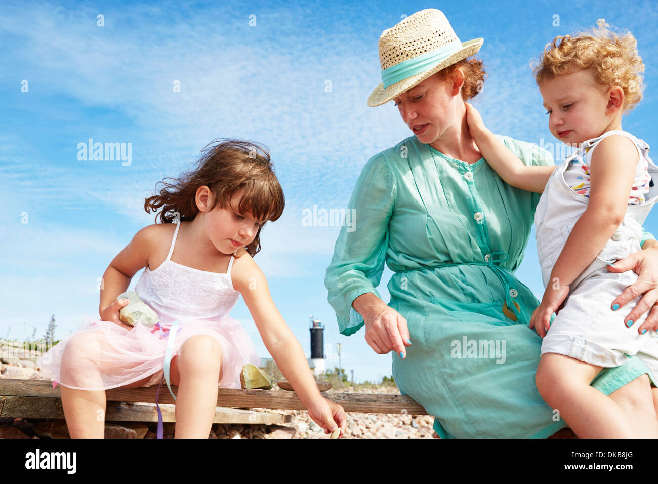 Mother and daughters on beach, Eggergrund, Sweden - Stock Image