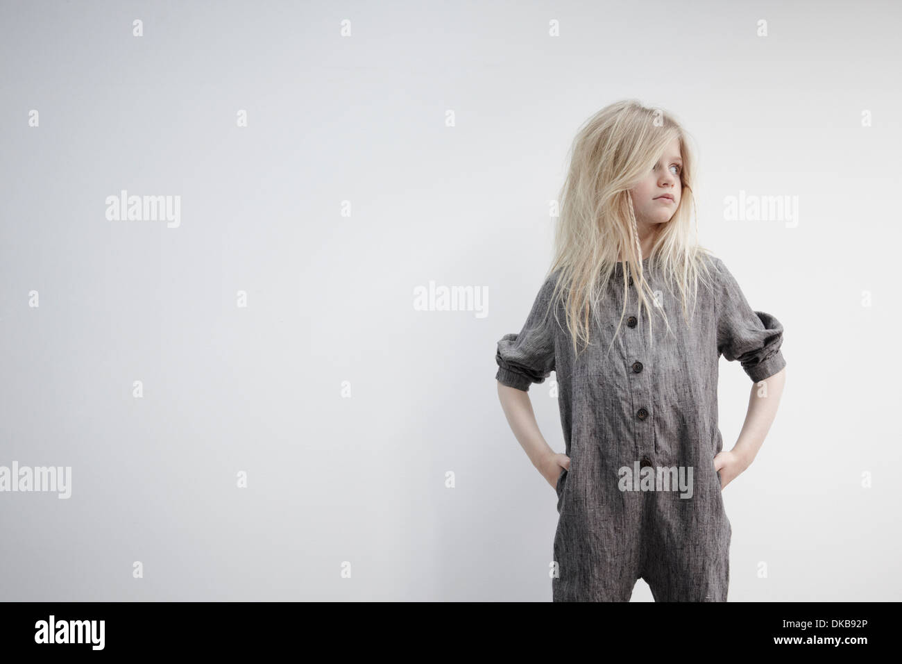 Portrait of girl with hands on hips - Stock Image